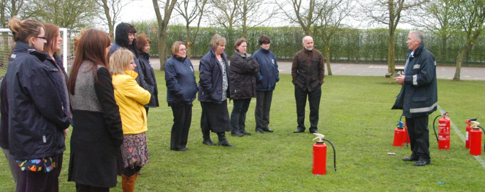 Learning how to use a fire extinguisher